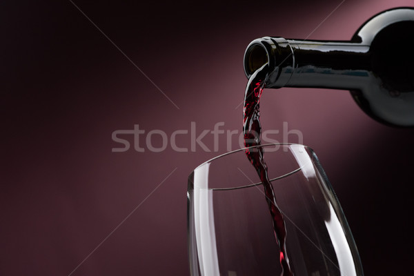 Pouring red wine into a wineglass Stock photo © stokkete