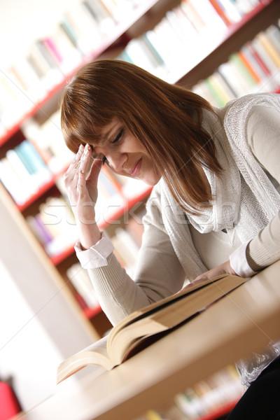 Stock photo: Female student has a headache