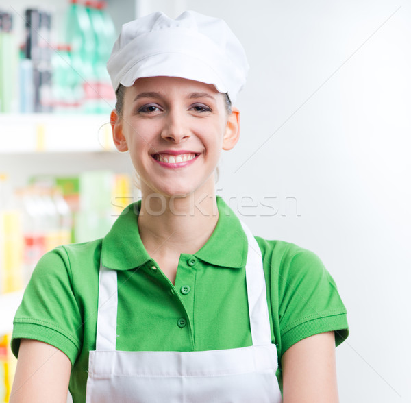 Female sales clerk working at supermarket Stock photo © stokkete