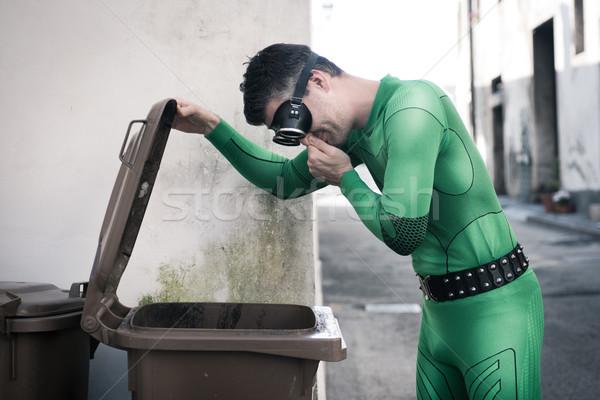 Superhero opening a trash bin Stock photo © stokkete