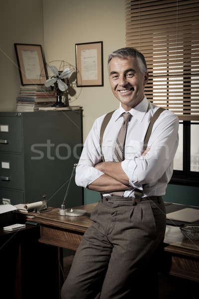 Confident businessman in his office Stock photo © stokkete