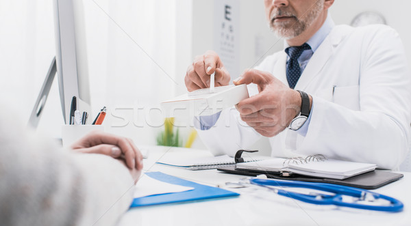Doctor giving a prescription medicine Stock photo © stokkete