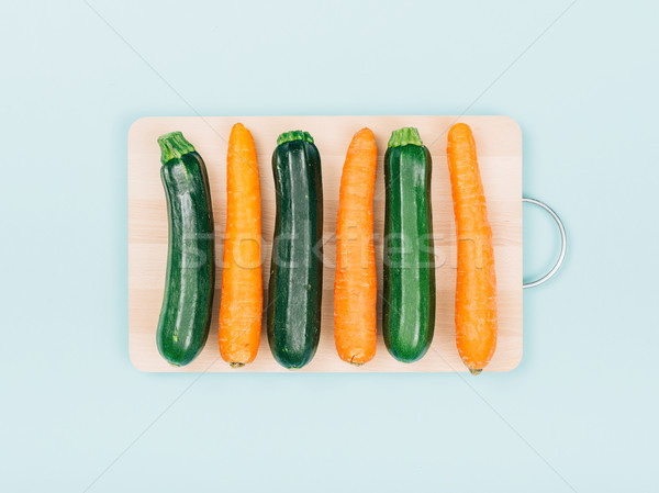 Carrots and zucchini on a chopping board Stock photo © stokkete