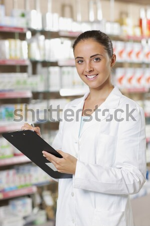 portrait of young healthcare worker and background pharmacy. Stock photo © stokkete