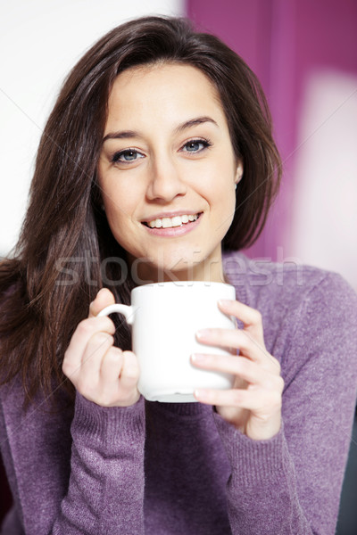 Portrait of a cute young lady with a cup of coffee Stock photo © stokkete