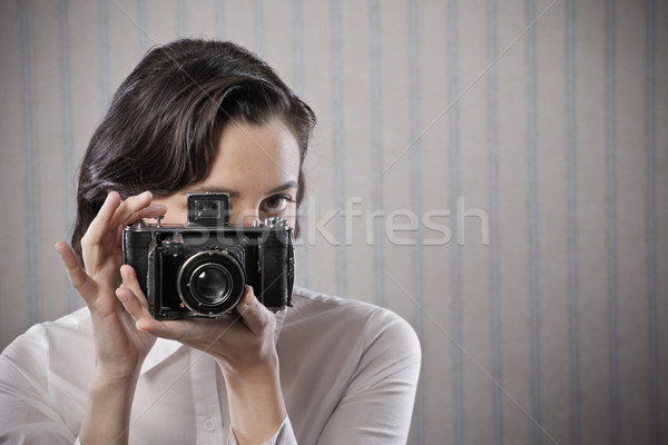 Woman with a old camera Stock photo © stokkete