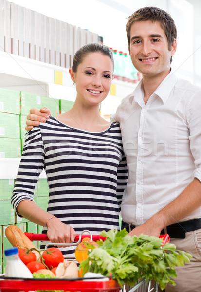 счастливым супермаркета улыбаясь пару Корзина Сток-фото © stokkete