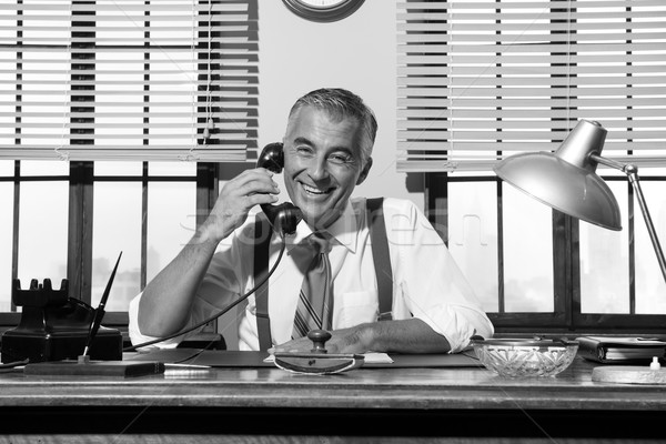 1950s smiling businessman on the phone Stock photo © stokkete