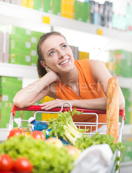 Pensive woman at store Stock photo © stokkete