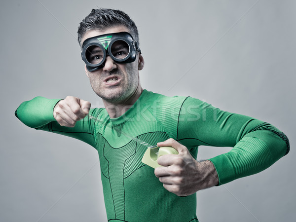 Funny superhero with scotch tape Stock photo © stokkete