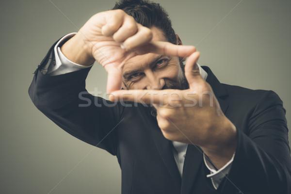 Vonzó férfi szemek ujjak mosolyog fókusz Stock fotó © stokkete