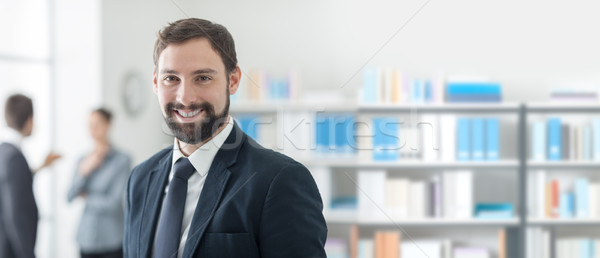 Confident executive posing in the office Stock photo © stokkete