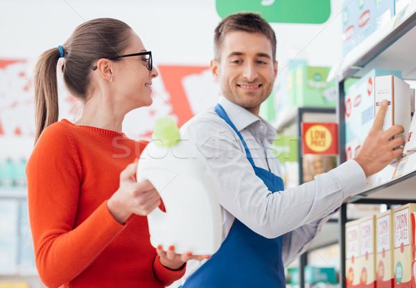 Supermarket clerk helping a customer Stock photo © stokkete