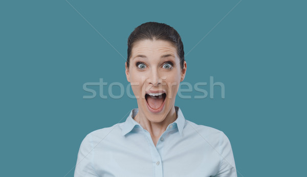 Surprised happy woman looking at camera Stock photo © stokkete
