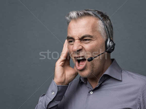 Angry customer support phone operator Stock photo © stokkete
