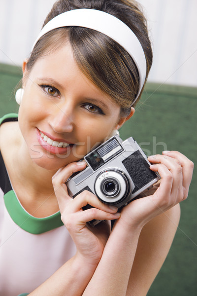 Retro woman with old-fashioned camera Stock photo © stokkete
