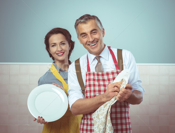 Vintage couple dish washing together Stock photo © stokkete