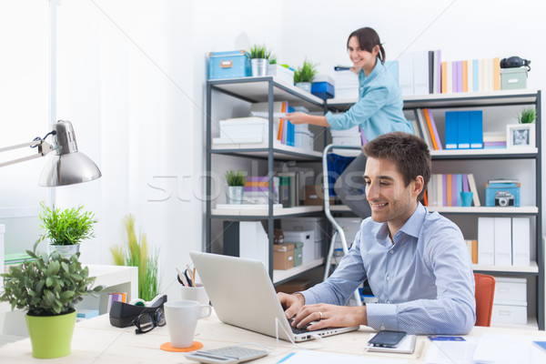 Two people working in the office Stock photo © stokkete