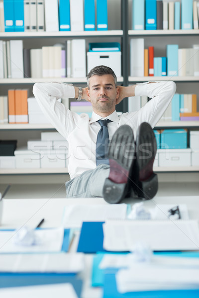 Lazy businessman in his office Stock photo © stokkete