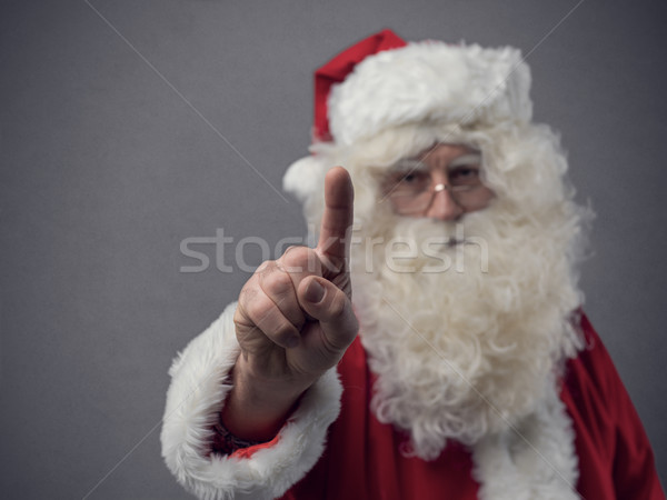Santa Claus using a touch screen user interface Stock photo © stokkete