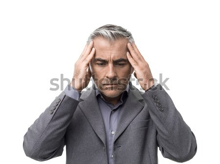 Tired businessman with headache Stock photo © stokkete