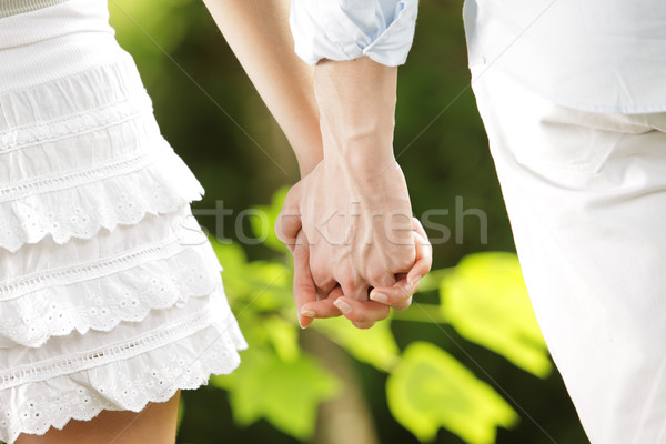 Stock photo: holding hands in a park