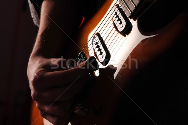rock guitarist on black background Stock photo © stokkete
