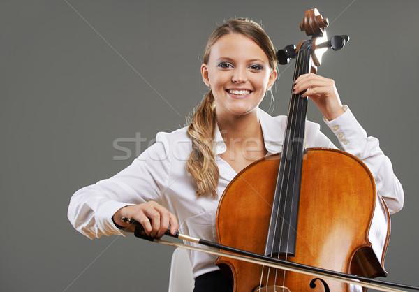 Piękna wiolonczelista uśmiechnięty młoda kobieta szary szczęśliwy Zdjęcia stock © stokkete