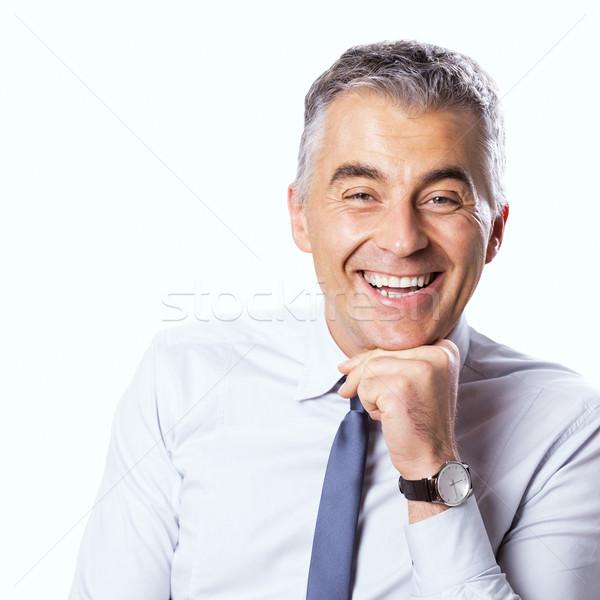 Godny zaufania biznesmen uśmiechnięty strony podbródek patrząc Zdjęcia stock © stokkete