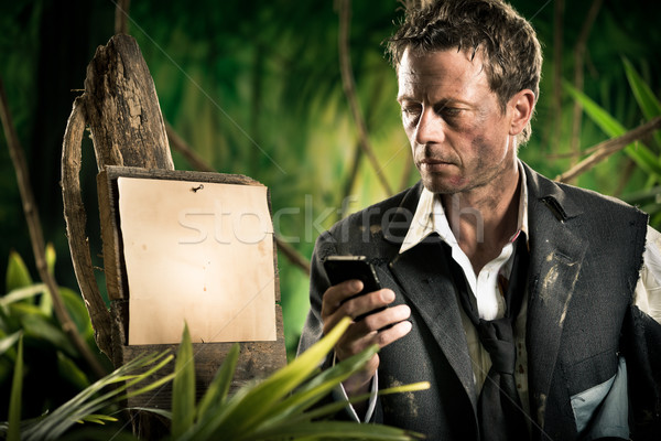 Businessman lost in jungle Stock photo © stokkete