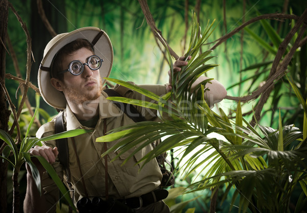 Young explorer lost in jungle Stock photo © stokkete