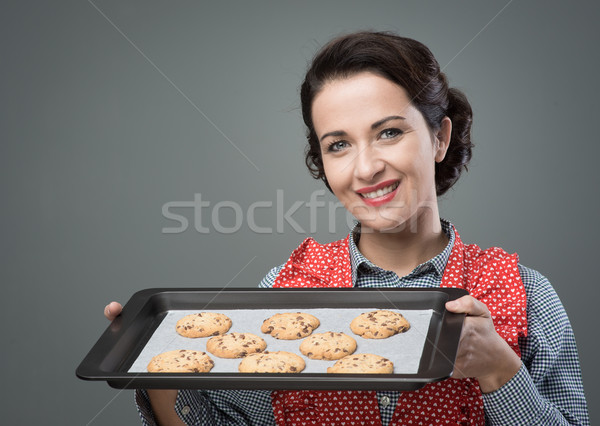 Vintage woman preparing homemade cookies Stock photo © stokkete