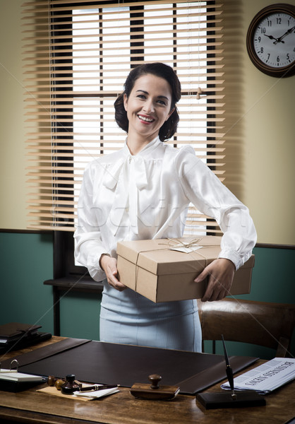 Smiling young secretary holding a mail package Stock photo © stokkete