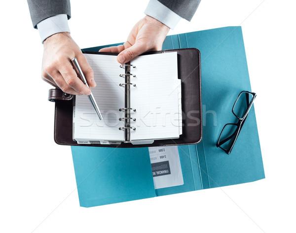 üzletember menetrend szervező asztal mutat toll Stock fotó © stokkete