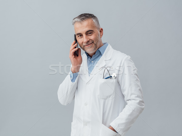 Medical service consultation by phone Stock photo © stokkete