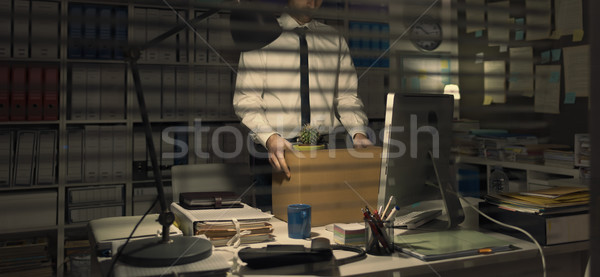 Fired office worker holding a box Stock photo © stokkete