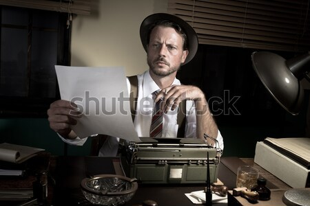 Detective smoking at desk Stock photo © stokkete