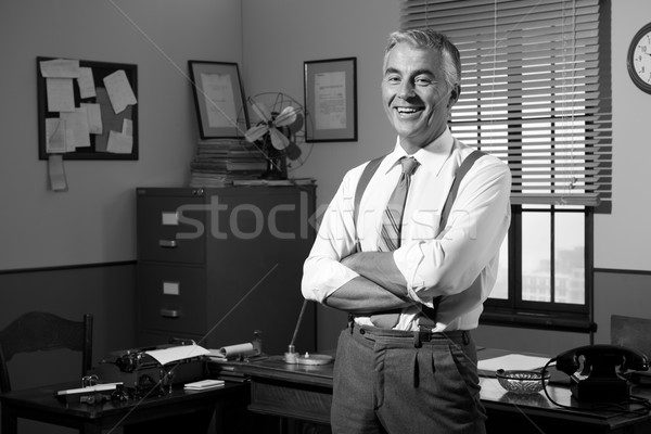 Empresário escritório sorridente 1950 estilo Foto stock © stokkete