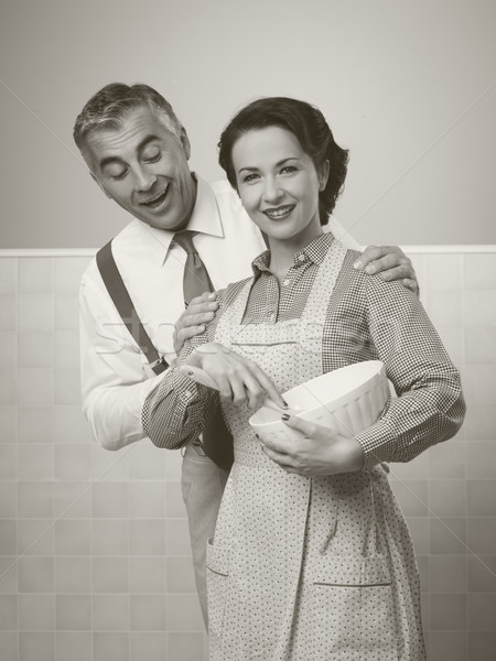 Loving couple cooking together Stock photo © stokkete