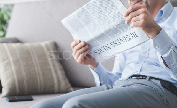 Businessman reading news Stock photo © stokkete