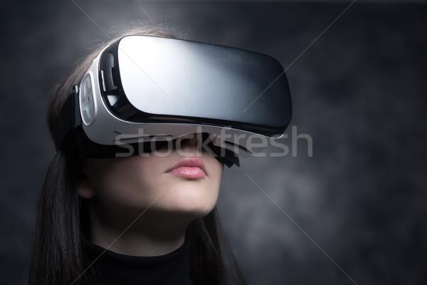Girl wearing a VR headset Stock photo © stokkete