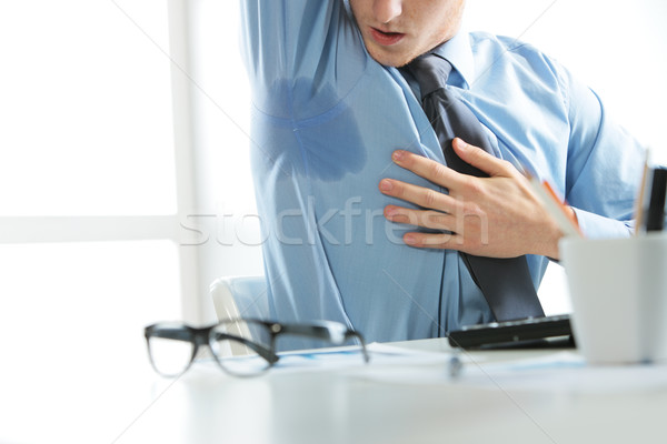 Businessman sweating Stock fotó © stokkete