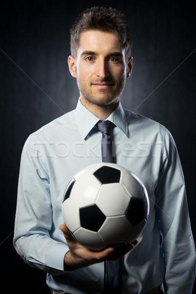 бизнесмен футбольным мячом молодые привлекательный улыбаясь Сток-фото © stokkete
