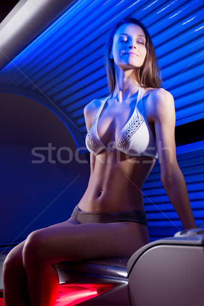 Güneşlenme solaryum bikini oturma Stok fotoğraf © stokkete