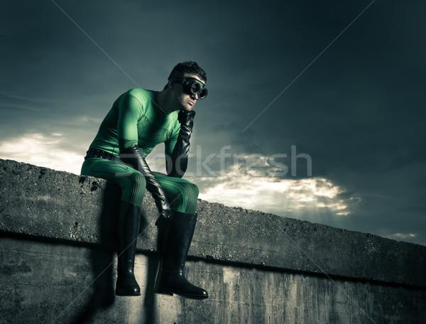 Pensive superhero against dark sky Stock photo © stokkete