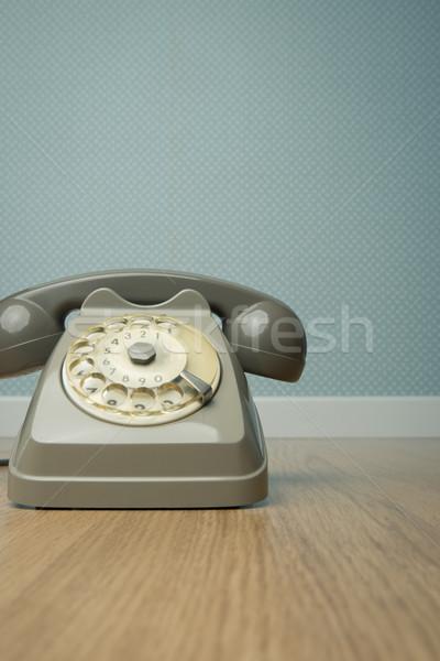 Gray vintage phone on the floor Stock photo © stokkete