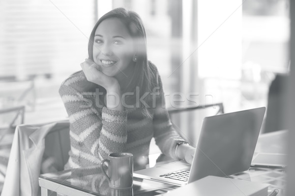 Stock photo: Pensive woman with laptop
