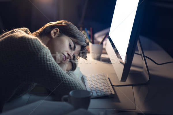 Tired woman sleeping on the desk Stock photo © stokkete