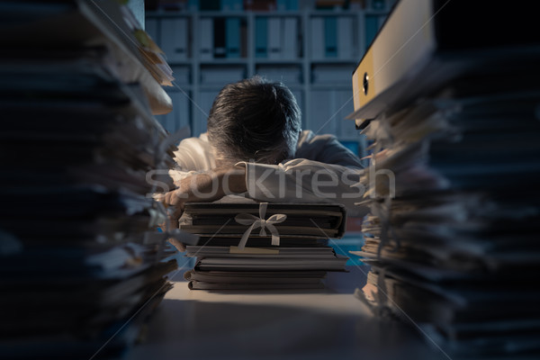 Office worker sleeping on the desk Stock photo © stokkete