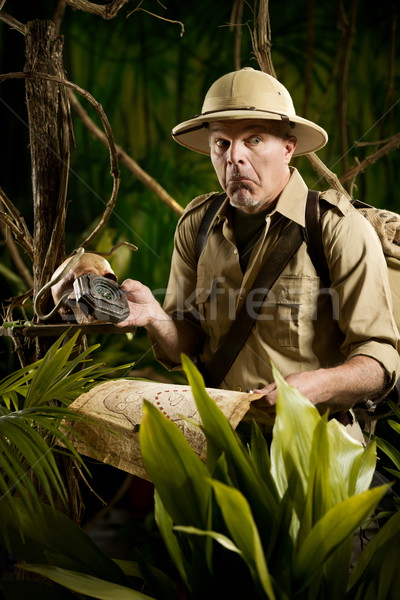 Adventurer lost in the jungle Stock photo © stokkete